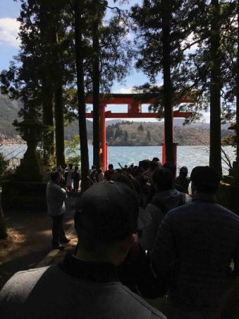 People. Lots of people patiently queuing up to take their signature photos at the grand tori gate at Lake Ashi.
