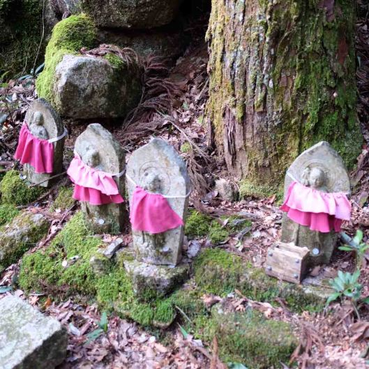 The many statues of Jizo in the forest.