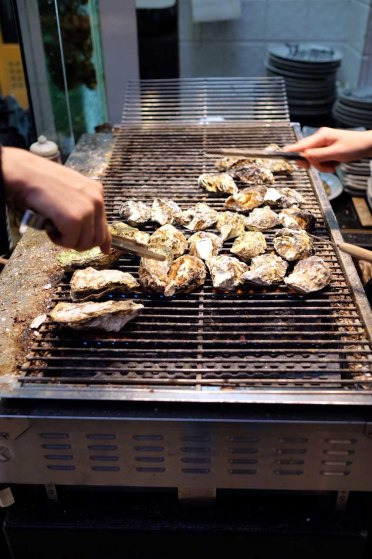 Grilling fresh oysters.