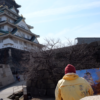 Spotted an artist and his painting of Osaka Castle.