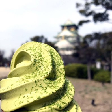 Matcha soft serve, and Osaka Castle in the background.