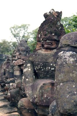 Rows of humanoid stone statues...warriors guarding the temple?