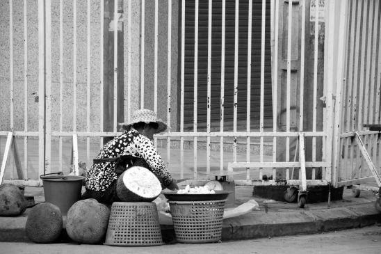 Woman selling melon.